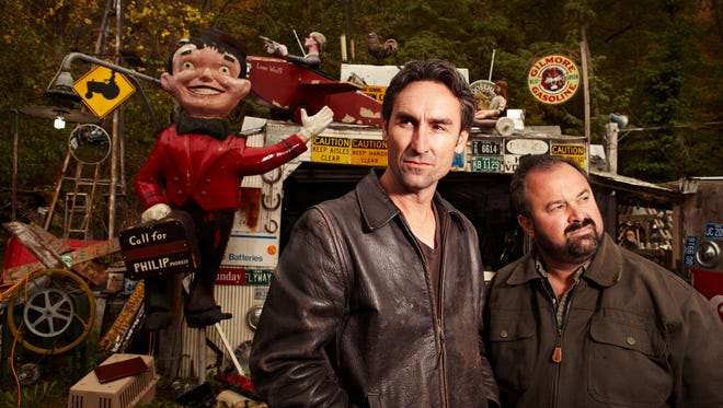 """Mike Wolfe, left, and Frank Fritz are the stars of the History Channel's """"American Pickers."""" Their business is based in LeClaire, Iowa, hometown of columnist Kate Kompas."""