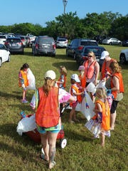 Girl Scouts from the Estero-based Troop 483 gear up for the annual coastal cleanup on Lovers Key, Saturday, Sept. 17.