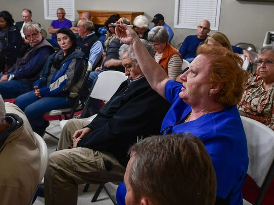 Teresa Morgan speaks about roads near Anderson County's solid-waste landfill during a community meeting Tuesday night at Cheddar fire station.