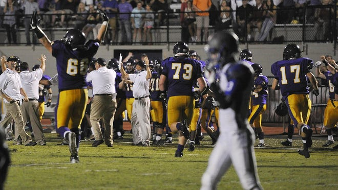 The Lipscomb bench celebrates after Page failed to make a two-point conversion with eight seconds left.