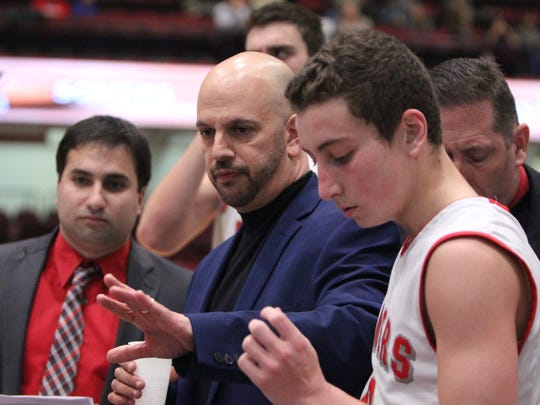 Somers head coach Chris DiCintio, center, at a Slam Dunk Tournament game with LaSalle at the Westchester County Center on Dec. 26.