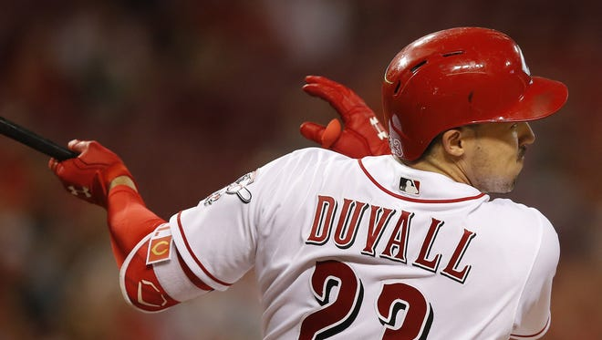 Cincinnati Reds left fielder Adam Duvall (23) hits a two-run home run in the third inning during the MLB National League baseball game between the New York Mets and the Cincinnati Reds, Tuesday, Sept. 6, 2016, at Great American Ball Park in Cincinnati.