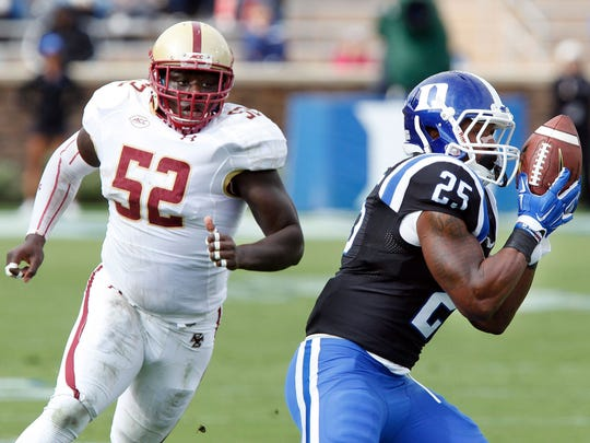 Duke Blue Devils running back Jela Duncan (25) catches the ball as Boston College Eagles linebacker Steven Daniels (52) chases at Wallace Wade Stadium in October.