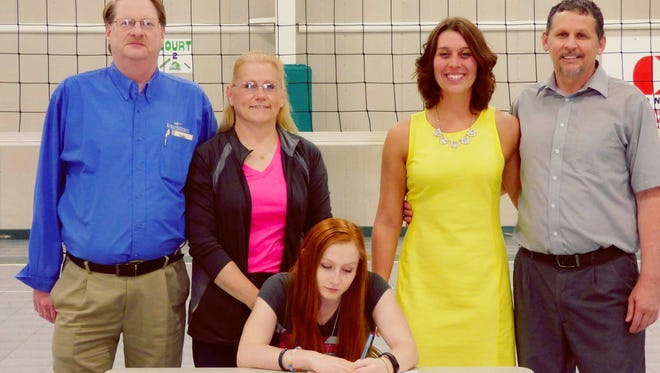 Rhieannae Cory (Front senter) signs with Muskingum to play volleyball with (Pictured left to right) Thomas and Dorothy Cory, Shauna Hurles and Mark Sisler