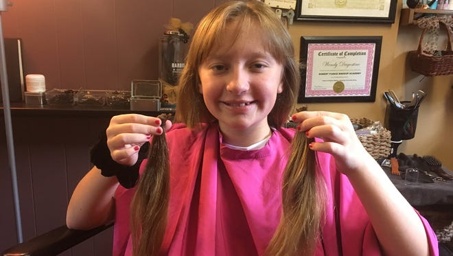 Jenni Creamer, 10, of Vineland donated her long hair to Locks of Love in August.