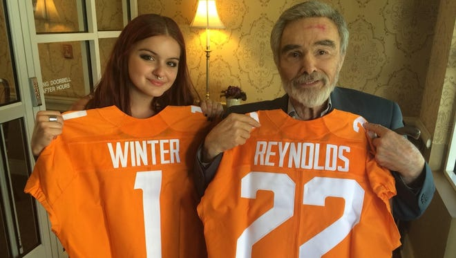"""""""The Last Movie Star"""" stars Ariel Winter, left, and Burt Reynolds hold up custom-made UT jerseys. The film was primarily shot in Knoxville in 2016."""