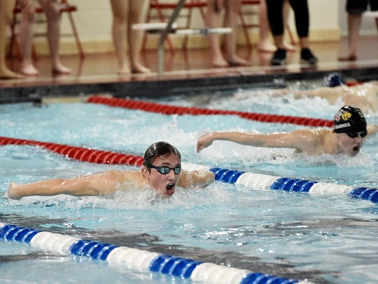 West York's Kieran McKee, left, swims the boys' 100-yard butterfly a YAIAA dual swim meet Thursday, Jan. 11, 2018, at Dover. Dover swept West York, with the girls winning 101-83 and boys winning 90-88. McKee came in second, with a time of 1:08.84.