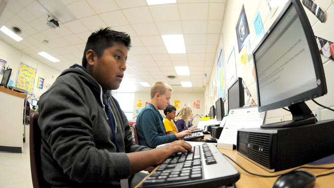 Sixth-grade students from Lombardi Middle School work in a computer lab. The Green Bay School District plans to spend more than $2 million on new technology as it pursues Common Core State Standards.