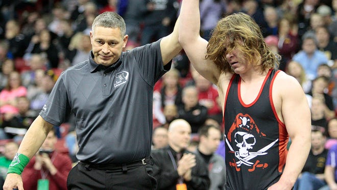 Pewaukee's  Jacob Raschka is crowned state champion after his win over  Reedsburg's Dalton Hahn in their 195-pound match at the WIAA state wrestling championship Saturday, Feb. 27, 2016 at the Kohl Center in Madison.