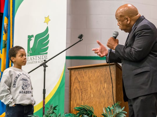 """Rep. John Lewis answers a question about """"Bloody Sunday,"""" the day hundreds of protestors in Selma, Ala. were beaten by those opposed to the Civil Rights Movement, posed by ten year-old Emory't Seeney (left), at the East Side Charter School on Friday morning."""