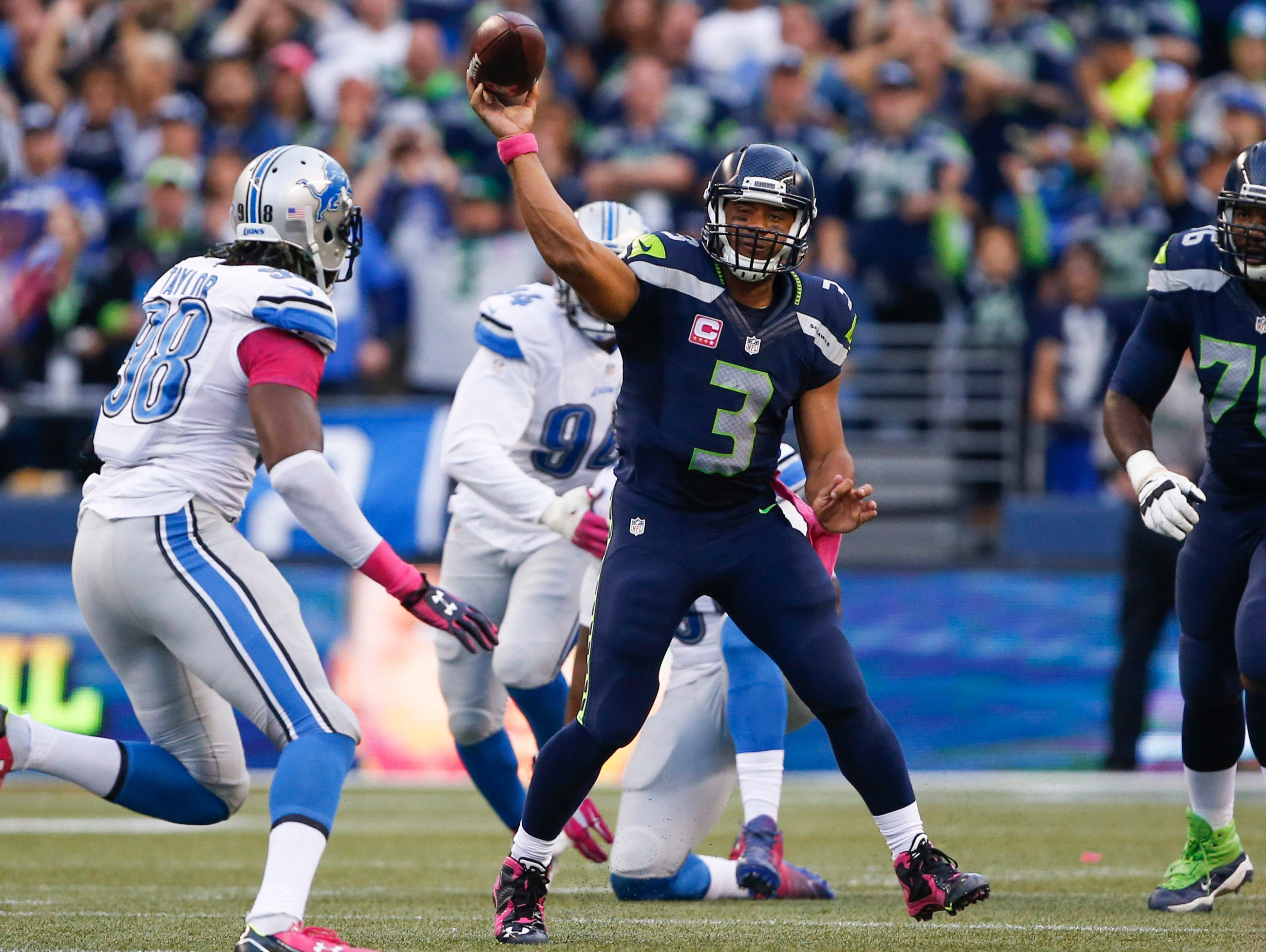 Oct 5, 2015; Seattle, WA, USA; Seattle Seahawks quarterback Russell Wilson (3) passes against the Detroit Lions during the second quarter at CenturyLink Field. Mandatory Credit: Joe Nicholson-USA TODAY Sports