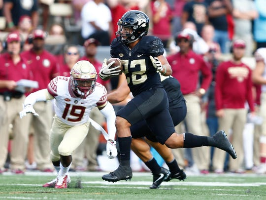 Wake Forest Demon Deacons running back Matt Colburn (22) runs the ball during the second quarter against the Florida State Seminoles at BB&T Field.