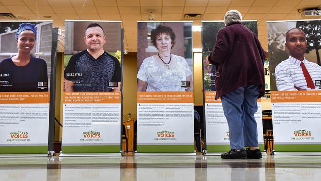 People view the Green Card Voices exhibit Monday, Jan. 8, at the Whitney Senior Center in St. Cloud. Sartell-St. Stephen school district has received an anonymous donation paying for the exhibit to come present to the district.