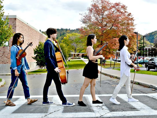 The Ithaca High School String Quartet poses in a photo