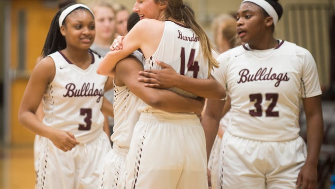 Bearden teammates hug each other following the AAA Sectional game between Bearden and Jefferson County at Bearden High on Saturday, March 3, 2018.