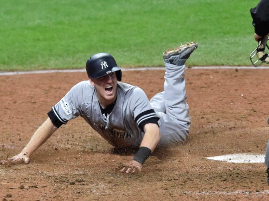 New York Yankees third baseman Todd Frazier (29) celebrates after scoring while Cleveland Indians catcher Roberto Perez (not pictured) attempts a tag in the ninth inning during game five of the 2017 ALDS playoff baseball series at Progressive Field on Oct. 11 2017.