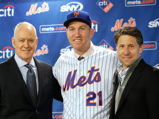 New York Mets general manager Sandy Alderson, left, poses with newly signed Mets third baseman Todd Frazier, center, and Mets owner Jeff Wilpon after the former New York Yankees player signed with the Mets, Wednesday, Feb. 7, 2018, in New York. Frazier reportedly signed a two-year deal, finalized on Wednesday. The contract calls for Frazier to be paid $8 million this year and $9 million in 2019.