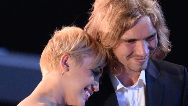 Jesse Helt accepts Video of the Year with singer Miley Cyrus on stage Sunday at the MTV Video Music Awards.