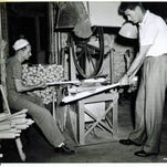Baseball legend Ted Williams visits the bat brander at the Louisville Slugger bat factory in Louisville, Ky.
