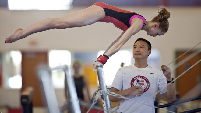 Rachel Gowey, shown with coach Liang Chow, hopes to earn a spot at the Pan-Am Games this summer.