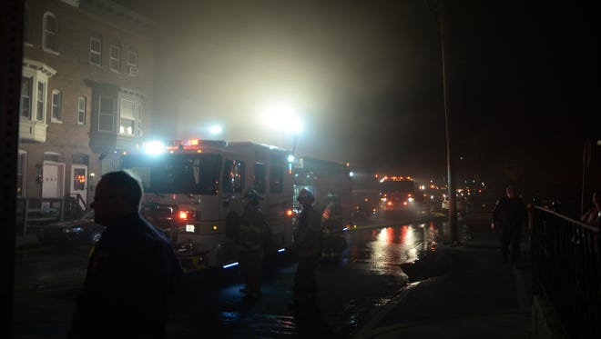 Fire trucks line up on South Queen Street while battling a fire on Oct. 29.