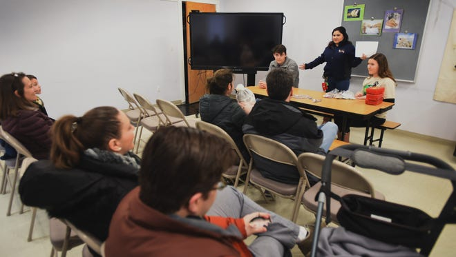 Annmarie Secreti (standing R), Zoo Educator, asks participants some quizzes about polar bear during a Polar Bears Day at Bergen County Zoo in Paramus on Feb. 26th, 2017.