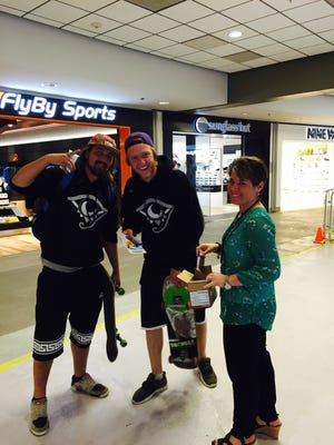 Passengers at Pittsburgh International Airport receive free snacks during a Fit2Fly event.