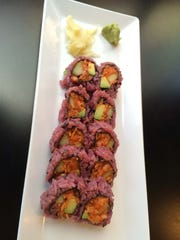 Spicy salmon roll is spicy tuna, avocado and cucumber