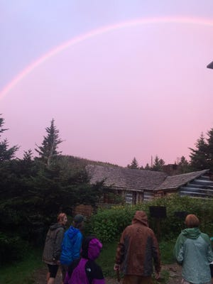 Hikers on the Friends of the Smokies hike to LeConte Lodge on July 20 stop still to enjoy a rainbow at sunset.