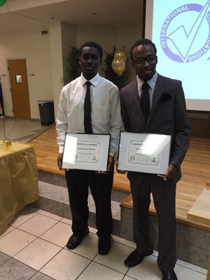 Anthany Bogar-Hatchett (left) and Emanuel Campbell received their Certified Production Technician credential last week which will give them a leg up on a job in the manufacturing sector.