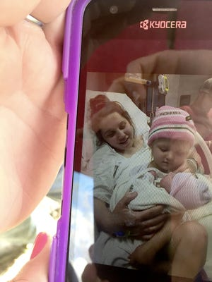 Hanna Rhoden and her daughter Sophia, 2, after giving birth to her daughter Kylie on April 17 in Pike County, Ohio, on Monday, April 25, 2016.