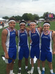 The Wynford Royals 4x100 relay team celebrates winning