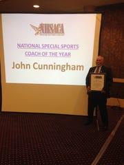 Veteran Canton gymnastics coach John Cunningham proudly