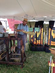 John Warren of Country Brooms demonstrates his craft at the folk festival.