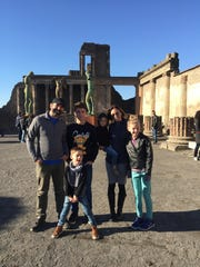Dad Nathan Merrill; Elijah Wagoner, 14; Thea, 3; mom Mary; Eva Wagoner, 11; and Henry, 5, at the ancient Roman city of Pompeii. As backup options in case the Make-A-Wish Foundation didn't send him to Italy, Henry said he'd like to go to the moon or meet a hotel owner.