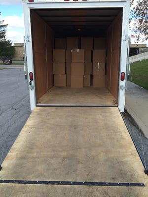 Boxes of unwanted prescription drugs collected last October are loaded into a trailer for transport to Indianapolis for incineration.