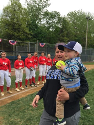 Hawthorne softball coach Jackie Forte holds her 20-month-old son Camden at the Breathe Easy Softball Tournament on Sunday. The event was held to raise awareness for cystic fibrosis, a rare disease Camden Forte battles.