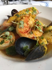 Wild Norwegian cod, mussels and shrimp bouillabaisse at  Bleu Provence.