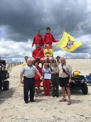 The U.S. Lifesaving Association awarded members of the Assateague State Park beach patrol with their official certification on the shore of the Atlantic Ocean May 26.