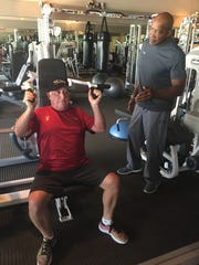 Nick Jimerson coaches Dave Baron on the proper technique of strength training after a shoulder injury.