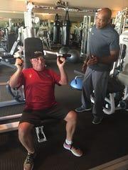 Nick Jimerson coaches Dave Baron on the proper technique