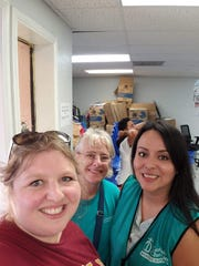 Lisa Speicher Munoz (left) and Cheryl Roberts take a photo together at the Catholic Charities Humanitarian Respite Center in McAllen, Texas, near the Mexican border.