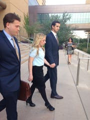 Logan (middle) and Austin Flake (right) leave the courthouse after pleading not guilty to charges of animal abuse in the Green Acre dog deaths case.
