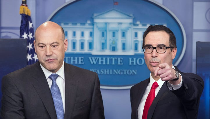 epa05929374 US Treasury Secretary Steven Mnuchin (R)