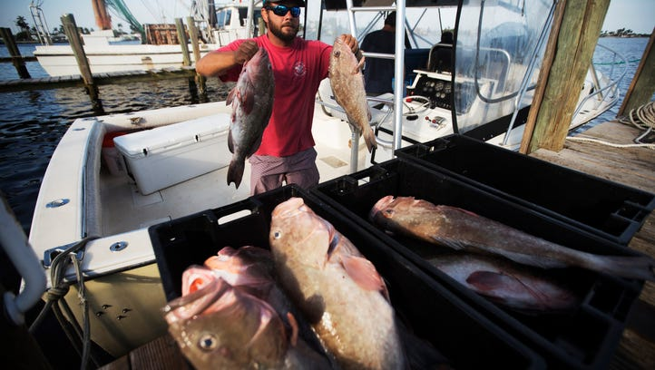 Capt. Casey Streeter unloads his catch at Island Seafood