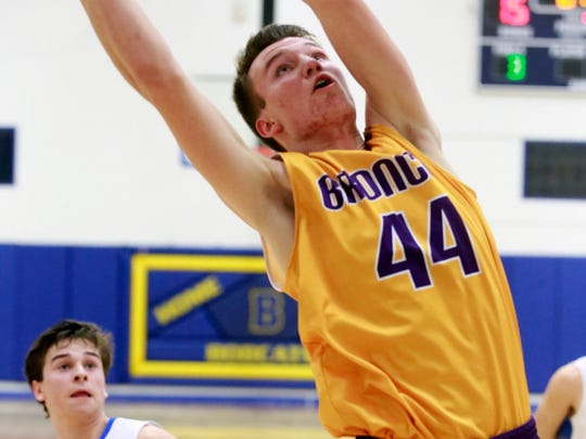 Kirtland Central's Bryson Dowdy comes up with a rebound in front of Bloomfield's Damion Sanchez on Feb. 20 at Bobcat Gym in Bloomfield.
