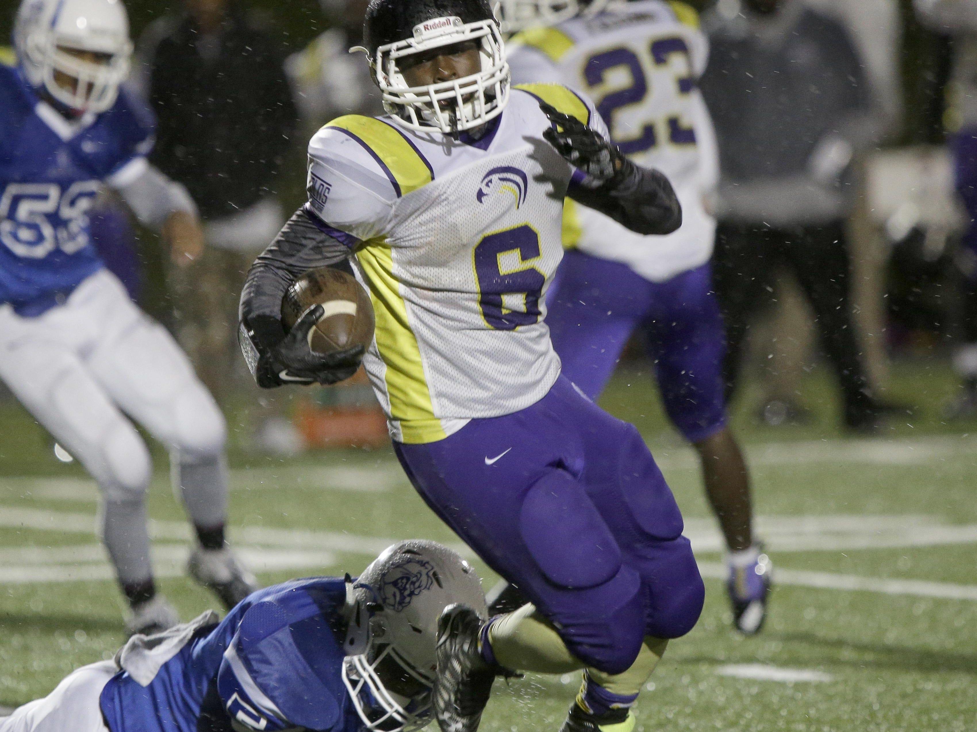 Aiken's Demonte Reece runs the ball during the Falcons' football game against Woodward Oct. 3.