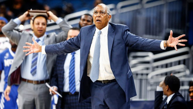 Memphis head coach Tubby Smith (front) is not happy with an officials call during first half action Tulsa in their AAC second round tournament game in Orlando, Fl., Friday, March 9, 2018.