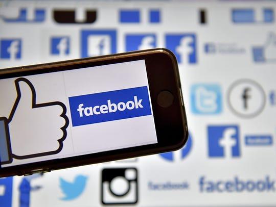 Image of a Facebook logo taken on a mobile phone.