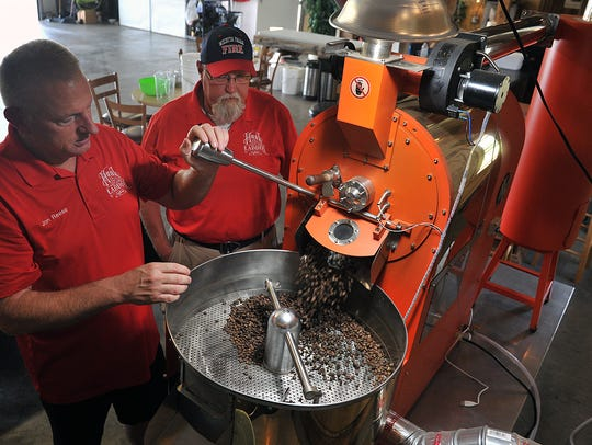 Jon Reese, left, and Bill Weske roast a batch of coffee beans for their business, Hook & Ladder Coffee Co. in this Times Record News file photo.